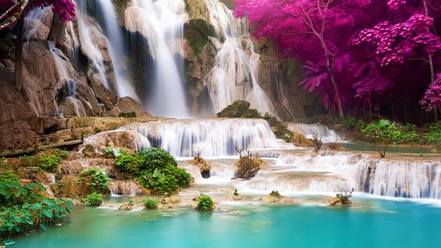Turquoise water of Kuang Si waterfall, Luang Prabang. Laos (Photo via Preto_perola / iStock / Getty Images Plusa)