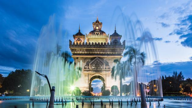 Patuxay monument is dedicated to the dead during the Independance war from France, shot during the blue hour in Vientiane, the capital city of Laos. (Photo via AsianDream / iStock / Getty Images Plus)
