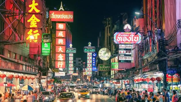 Cars and shops on Yaowarat road, the main street of Chinatown, Bangkok (photo via SAHACHAT / iStock / Getty Images Plus)