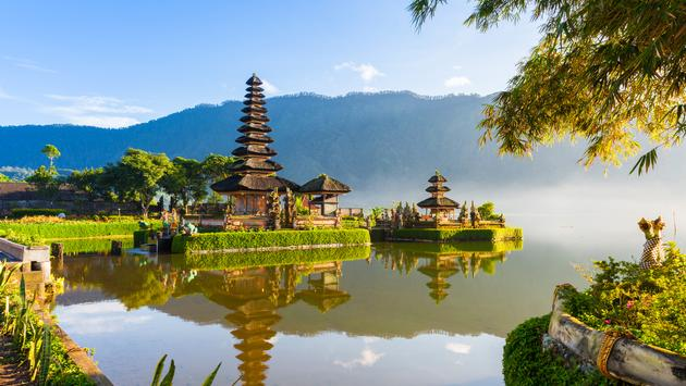 Pura Ulun Danu Bratan at sunrise, famous temple on the lake, Bedugul, Bali, Indonesia. (Photo via ErmakovaElena / iStock / Getty Images Plus)