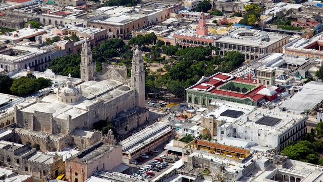 Aerial view of downtown Merida, Yucatan's city square and cathedral. (photo via segarza / iStock / Getty Images Plus)