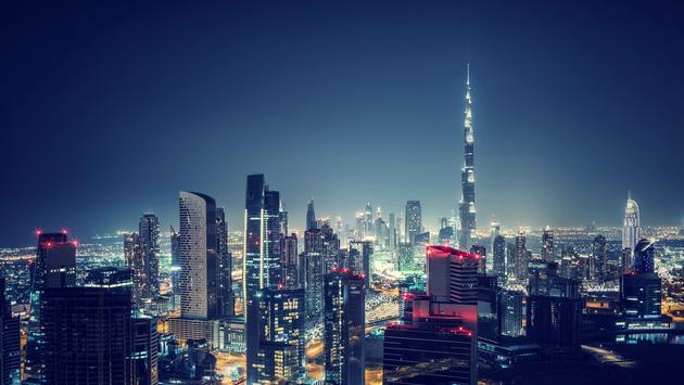 Beautiful Dubai cityscape, bird's eye view on a night urban scene, modern city panoramic landscape, United Arab Emirates (photo via Anna_Om / iStock / Getty Images Plus)