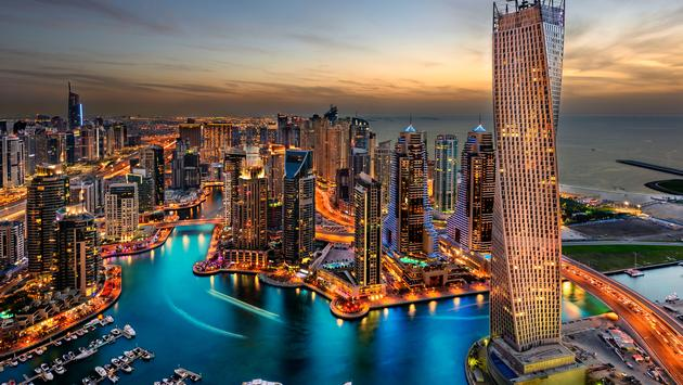 Dubai Marina from a high view showing the boats, sea, and the city scape. (photo via JandaliPhoto / iStock / Getty Images Plus)