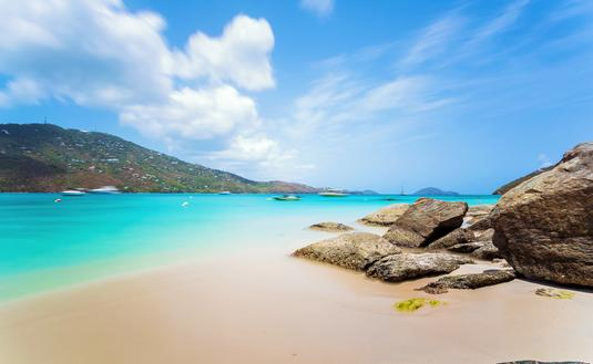 Idyllic beach at Magens Bay, Saint Thomas, US Virgin Islands. This beach is considered one of the best top ten beaches in the world. Paradise and clear water for relaxation. (photo via poladamonte / iStock / Getty Images Plus)