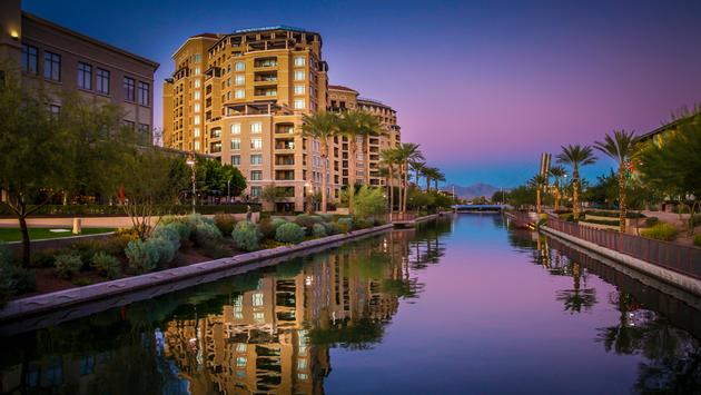 Arizona Canal running through Scottsdale,Az,USA at sunset (photo via BCFC / iStock / Getty Images Plus)