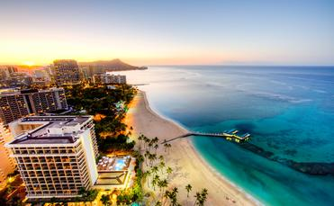 Sunrise at Waikiki Beach, Hawaii (photo via Andy_Tam / iStock / Getty Images Plus)