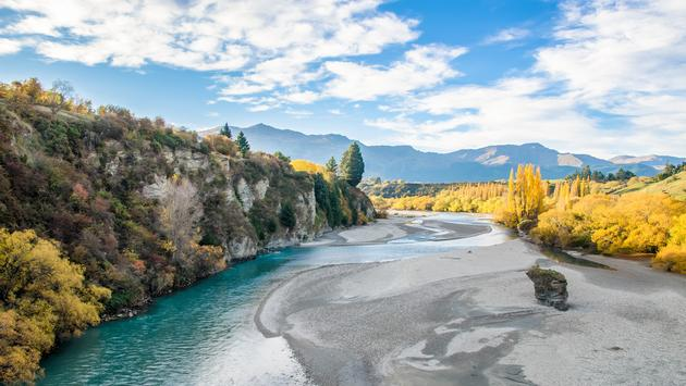 Beautiful view from the Historic Bridge over Shotover River in Arrowtown, New Zealand. (gracethang / iStock / Getty Images Plus)