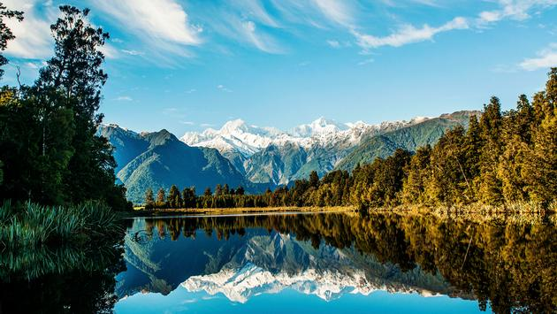 Reflections of Mount Cook and Mount Tasman in Lake Matheson, Fox Glacier New Zealand. (JasmineMonrouxePhotography / iStock / Getty Images Plus)