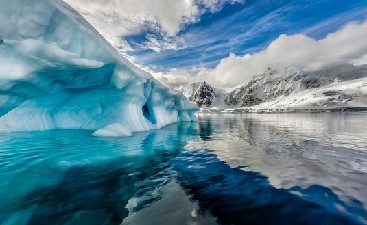 Iceberg floats in Andord Bay on Graham Land, Antarctica. (Photo via jocrebbin / iStock / Getty Images Plus)