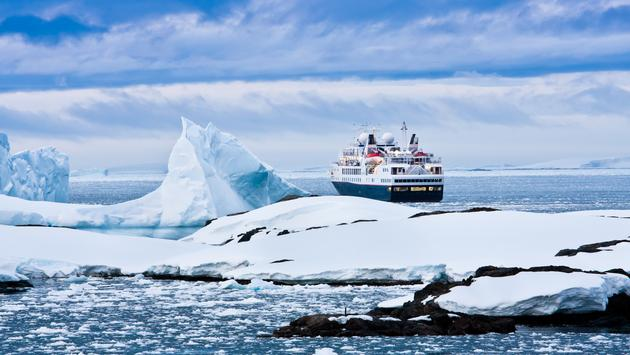 Big cruise ship in the Antarctic waters (Photo via goinyk / iStock / Getty Images Plus)