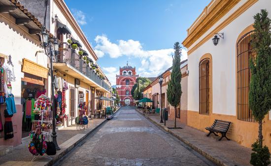 Pedestrian street and Del Carmen Arch Tower (Arco Torre del Carmen) - San Cristobal de las Casas, Chiapas, Mexico (photo via diegograndi / iStock / Getty Images Plus)