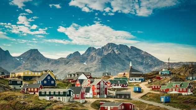 view of a colorful village in Greenland (photo via Elizabeth M. Ruggiero/iStock/Getty Images Plus)