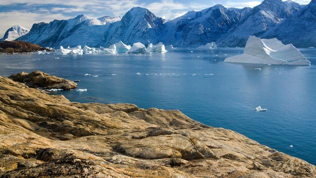 Northwest Fjord in the far reaches of Scoresbysund in eastern Greenland (photo via SteveAllenPhoto/iStock/Getty Images Plus)