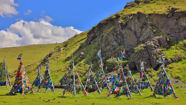Shaman Adak Tree, prayer's flag, Mongolia (photo via zgr_pro / iStock / Getty Images Plus)