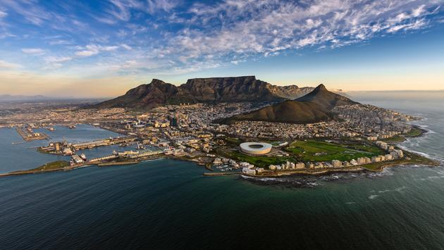 Vintage shot of a Beautiful beach in Cape Town, with Lion's Head mountain (Photo via vwPix/ iStock / Getty Images Plus)