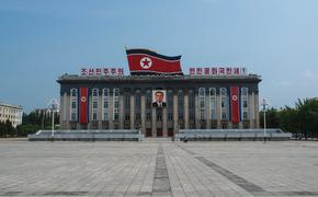 Pyongyang, North Korea – July 27, 2011: The Kim Il-Sung Square is named after the founding leader of the DPRK. It opened in August 1954. The square is located on the west bank of the Taedong River, directly opposite of the Juche Tower. The square is the c