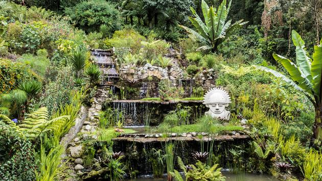 Waterfall with small statue, in Columbia, Bogota (Photo via skracht / iStock / Getty Images Plus)