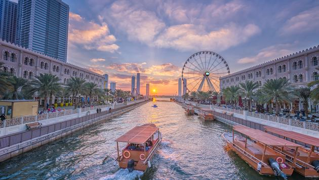 Eye of the Emirates - Ferris wheel in Al Qasba - Shajah at sunset (photo via MesamLens / iStock / Getty Images Plus)