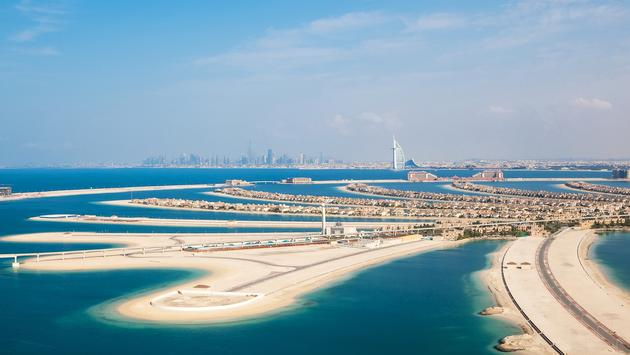 DUBAI, UAE - JANUARY 20: The Palm on January 20, 2011 in Dubai, UAE. The Palm is an artificial island with many luxury hotels and villas. Helicopter view (photo via romrodinka / iStock / Getty Images Plus)