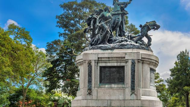 National monument of Costa Rica is a sculptural group located in the National Park of San Jose. The sculpture is cast in bronze on a pedestal, where there are five female figures carrying weapons. Greatest figure, that is stands in the center of the joint