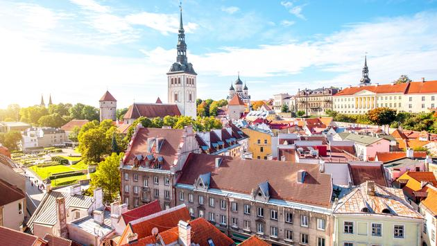 Cityscape aerial view on the old town with saint Nicholas church tower and Toompea hill in Tallin, Estonia (photo via RossHelen / iStock / Getty Images Plus)