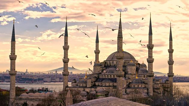 Sunset over The Blue Mosque in Sultanahmet district, Istanbul, Turkey. (photo via MasterLu / iStock / Getty Images Plus)