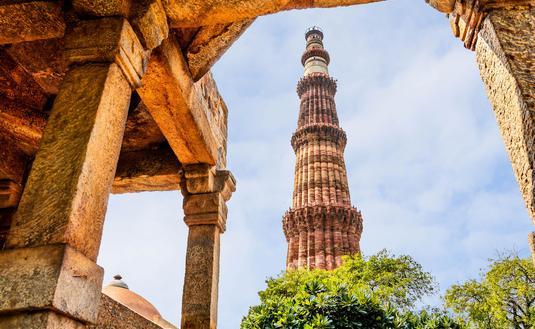 Qutub Minar Tower, Delhi India (photo via DVrcan / iStock / Getty Images Plus)