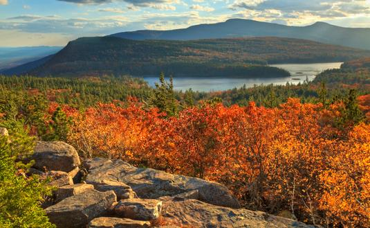 Afternoon sun on sunset rock in the Autumn, overlooking North-South Lake in the Catskills Mountains of New York. (HDR).' (lightphoto / iStock / Getty Images Plus)