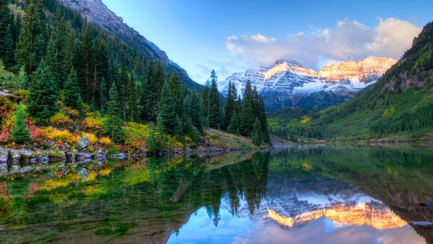 Reflection of Snowcapped Maroon Bells in fall, at sunrise. (Photo via tonda / iStock / Getty Images Plus)