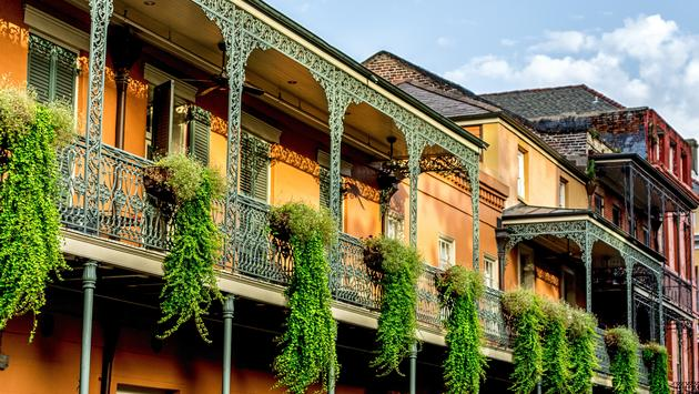 New Orleans LA USA 6/30/15: Balconies in the French Quarter with plants hanging off of them. (Photo via GregJK / iStock / Getty Images Plus)