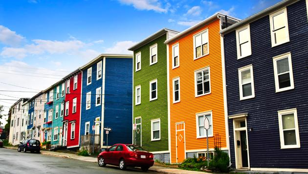 Street with colorful houses in St. John's, Newfoundland, Canada (photo via Elenathewise/iStock / Getty Images Plus)