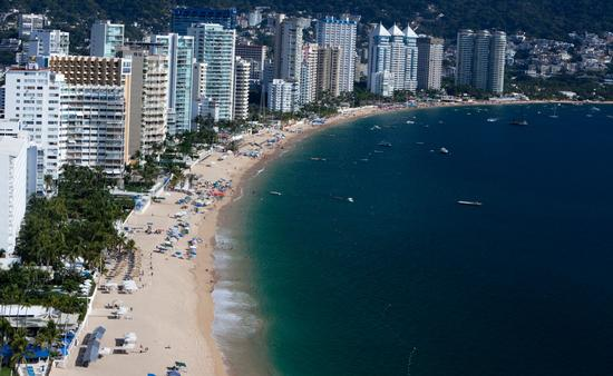 Overlooking view of Acapulco Bay, Mexico. (photo via Aneese/iStock/Getty Images Plus)