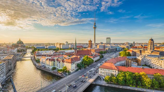 Berlin skyline with Spree river at sunset, Germany (Photo via bluejayphoto / iStock / Getty Images Plus)