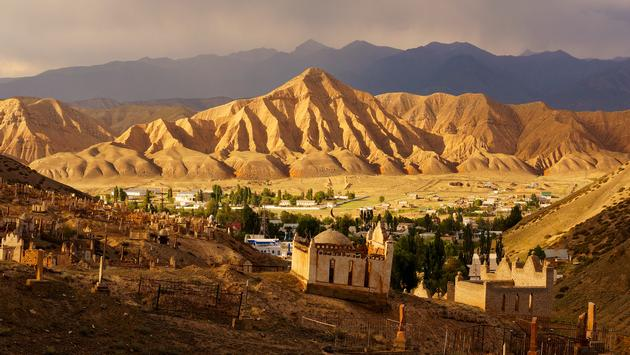 Naryn town, centre of Naryn region, Kyrgyzstan. View of the central part of town from the old Kyrgyz cemetery. (Photo via yuriboyanin / iStock / Getty Images Plus)