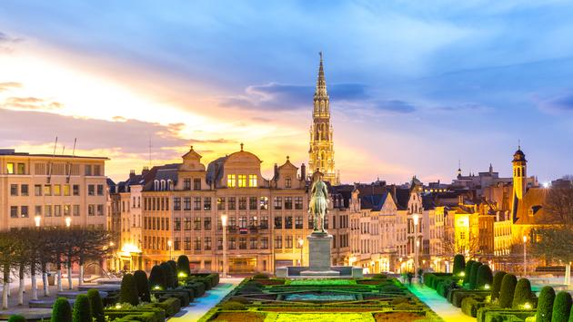 Brussels Cityscape from Monts des Arts at dusk, Belgium (Photo via  vichie81 / iStock / Getty Images Plus)