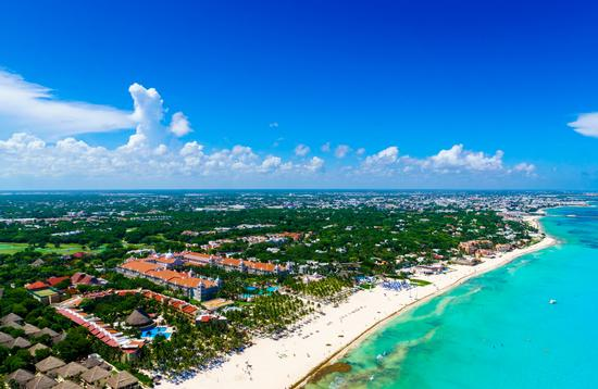 Playa del Carmen aerial view of the beautiful white sand beaches and blue turquoise water of the Caribbean ocean (Photo via HT-Pix / iStock / Getty Images Plus)