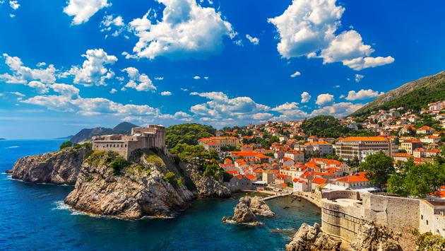 Croatia. South Dalmatia. General view of Dubrovnik - Fortresses Lovrijenac (left side) and Bokar seen from south old walls (it is on UNESCO World Heritage List since 1979) (photo via WitR / iStock / Getty Images Plus)
