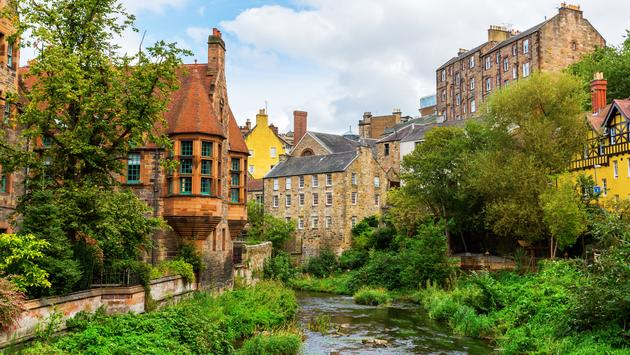 picturesque Dean Village along the river Leith in Edinburgh, Scotland (photo via Christian Mueller / iStock / Getty Images Plus)