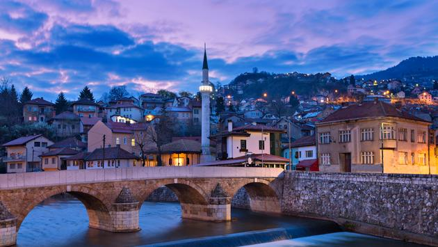 Skyline of the old town at the sunrise in Sarajevo, Bosnia and Herzegovina. (photo via Ozbalci / iStock / Getty Images Plus)