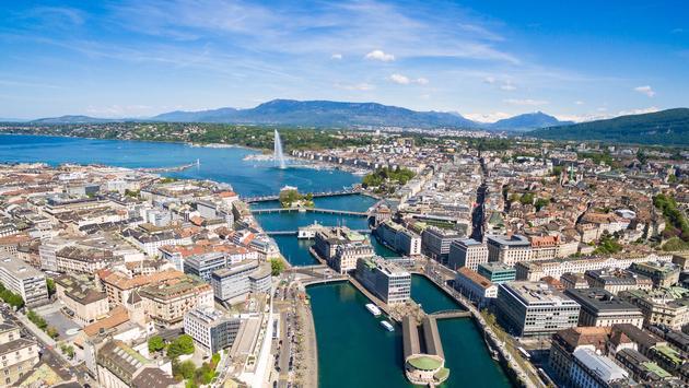 Aerial view of Geneva city in Switzerland (photo via sam74100/iStock/Getty Images Plus)