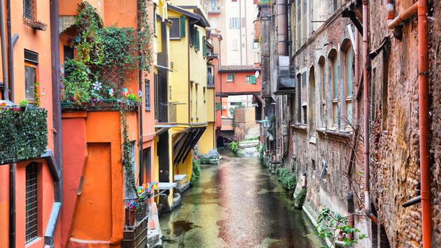Canal in the old town of Bologna, Italy (Photo via  zoom-zoom / iStock / Getty Images Plus)