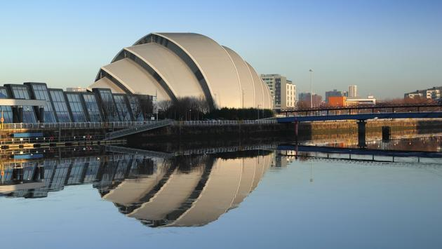Glasgow's Armadillo in winter sunshine reflected off River Clyde (photo via moonmeister/iStock/Getty Images Plus)
