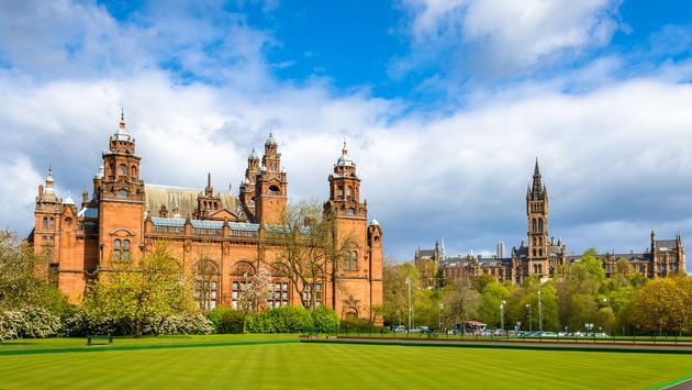 Kelvingrove Museum and Glasgow University - Scotland (photo via Leonid Andronov/iStock/Getty Images Plus)