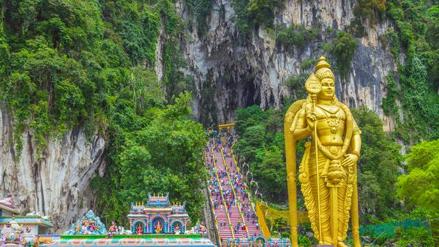 Batu Caves Lord Murugan Statue and entrance near Kuala Lumpur Malaysia (Photo via VladyslavDanilin / iStock / Getty Images Plus)