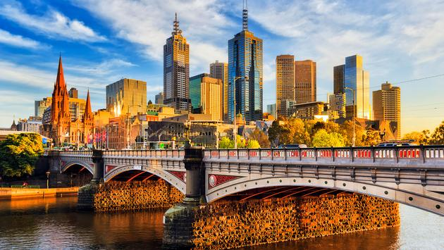 Warm morning light on high-rise towers in Melbourne CBD above Princes bridge across Yarra river. (photo via zetter / iStock / Getty Images Plus)