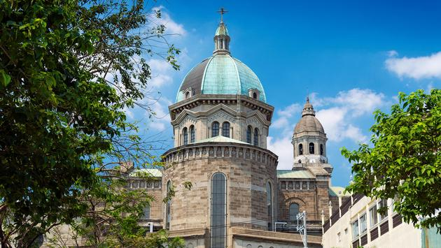 manila cathedral landmark in intramuros phillipines (photo via jackmalipan / iStock / Getty Images Plus)