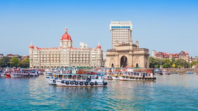 The Gateway of India and boats as seen from the Mumbai Harbour in Mumbai, India (saiko3p / iStock / Getty Images Plus)