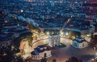 panoramic view of Milan at night (photo via Grosescu Alberto Mihai / iStock / Getty Images Plus)