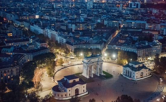 panoramic view of Milan at night (photo via Grosescu Alberto Mihai / iStock / Getty Images Plus)