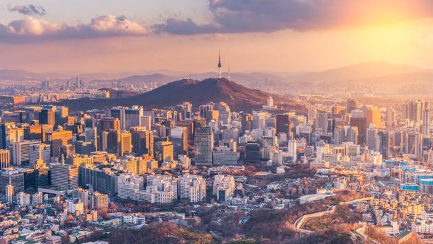 Sunset at Seoul City Skyline,South Korea (photo via Reabirdna / iStock / Getty Images Plus)
